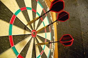 Darts - Darts in a dartboard