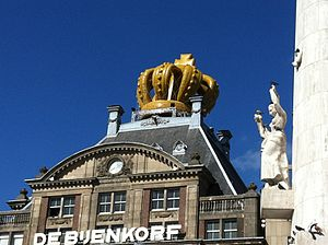 De Bijenkorf - A crown-like balloon on top of Bijenkorf Amsterdam on Koningsdag, 2013