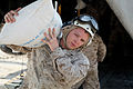 Defense.gov News Photo 100911-A-9180B-004 - A U.S. Marine Corps corporal from the 26th Marine Expeditionary Unit unloads a bag of flour from a CH-53E Sea Stallion helicopter in support of the.jpg