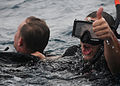 Defense.gov News Photo 101108-N-0120A-122 - U.S. Navy Petty Officer 3rd Class Andres Acosta right signals to a boat crew while rescuing Petty Officer 1st Class Kurt Bartholomai during search.jpg