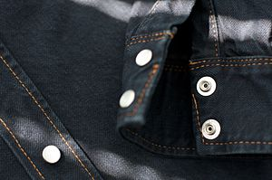 Denim - Denim fabric dyed with indigo and black dyes and made into a shirt