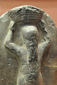 Detail of a stone monument of Shamash-shum-ukin as a basket-bearer. 668-655 BCE. From the temple of Nabu at Borsippa, Iraq and is currently housed in the British Museum.jpg