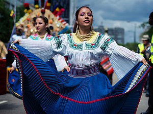 Ecuadorians - A mestizo woman in Ecuadorian garment participating in the 2010 Carnaval del Pueblo.