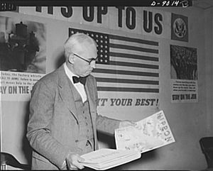 United States Office of War Information - Elmer Davis, Director of the Office of War Information, examines Nazi and Japanese propaganda organs.