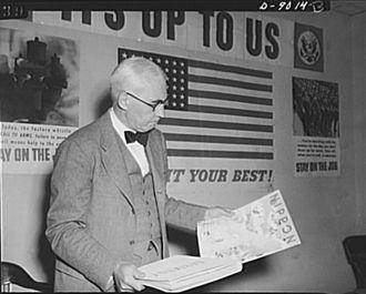 United States Office of War Information - Elmer Davis, Director of the Office of War Information, examines Nazi and Japanese propaganda organs.