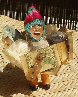 Ekeko - Ekeko figurine attached with a United States dollar to attract wealth.