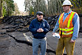 FEMA - 40128 - FEMA PIO and WA DOT employee at a broken road in Washington.jpg