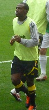 A colour photograph of Fabrice Muamba, in training before a league match.