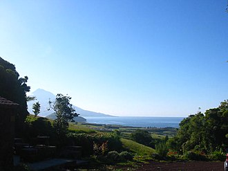 Feteira (Horta) - The southern coast of Faial as seen from the foothills of Feteira, with the summit of Pico in the east
