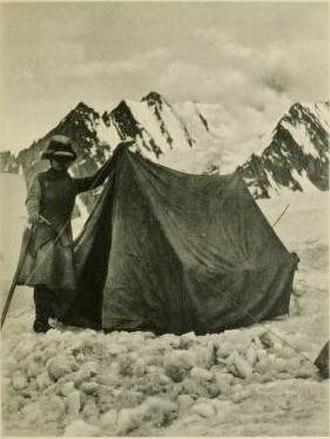 Mummery tent - Fanny Bullock Workman beside her Mummery tent in the Karakoram
