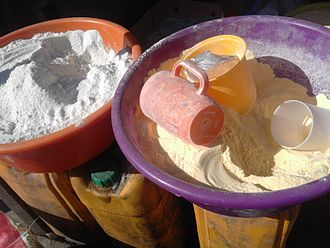 Flour - Cassava flour (left) and corn flour (right) in Kinshasa, Democratic Republic of Congo. These flours are basic ingredients for the cuisine of Central Africa.