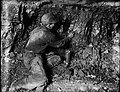 File-C4059--Unknown location--Coal mine scene--Man with lamp -1917.05.14- (874ff087-7ceb-4786-b3be-f6365336e965).jpg