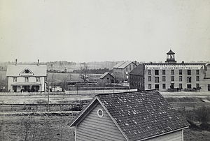 Durham, North Carolina - Early view of first Duke tobacco factory and family home, Durham, 1883