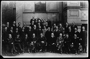 First Dáil - Members of the First Dáil, 10 April 1919 First row, left to right: Laurence Ginnell, Michael Collins, Cathal Brugha, Arthur Griffith, Éamon de Valera, Count Plunkett, Eoin MacNeill, W. T. Cosgrave and Ernest Blythe. Kevin O'Higgins is in the third row (right)