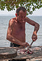 Fisherman gutting the fish.jpg