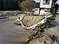 Flood eroded road and collapsed guardrails in Asakura.jpg