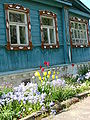 Flowers and Traditional Wooden House - Suzdal - Russia.JPG