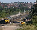 Freightliner Class 66 605 crosses the ladder at Kettering North with Dagenham-Hope discharged cement tanks.jpg