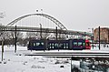 Fremont Bridge with Portland Streetcar in snow at Tanner Springs Park.jpg