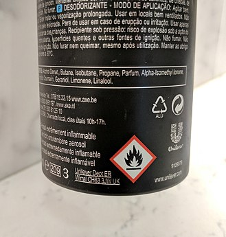 Globally Harmonized System of Classification and Labelling of Chemicals - A flammable warning symbol on the back of a European Axe deodorant spray.