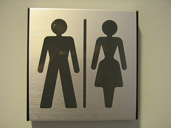 English: Gender neutral toilet sign at departm...