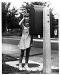 Girl Mailing a Letter (2550243063).jpg
