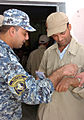 Government of Iraq makes initial payments to Sons of Iraq DVIDS128916.jpg