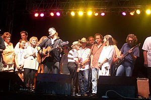 Woody Guthrie Folk Festival - Jimmy LaFave on stage for the 2006 grand finale with members of the Guthrie family and other artists.  July 14, 2006.