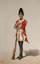 Print shows a standing soldier in a red coat with black gaiters and white breeches, turnbacks, and waistcoat. This soldier holds a musket and wears a tall bearskin hat.