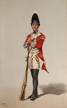 Print shows a standing soldier in a red coat with black gaiters and white breeches, turnbacks, and waistcoat. The soldier holds a musket and wears a tall bearskin hat.