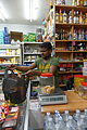 Grocery store interior and vendor in Paris France.jpg