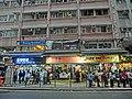 HK Wan Chai Road evening Bus stop visitors Mar-2014 facade.JPG