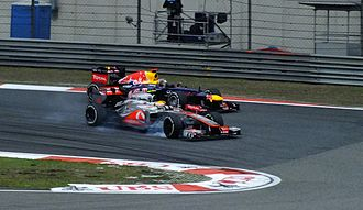 2012 Chinese Grand Prix - Lewis Hamilton fighting Sebastian Vettel for position