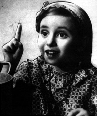 Faten Hamama - Hamama in her first film, Happy Day (1940)