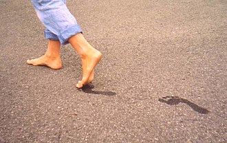 Barefoot - Barefooted person leaving footprints behind.