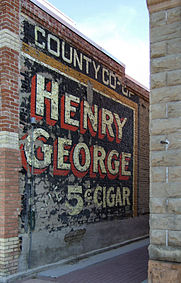 henry george ghost sign