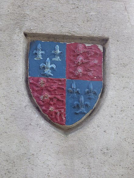 The school's arms on a monument in the town High Cross - Pride Hill, Shrewsbury - shield (24959800024).jpg