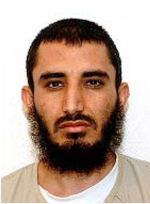 Obaidullah (detainee) - Obaidullah's Guantanamo identity portrait, showing him wearing the white uniform issued to compliant individuals