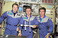ISS-01 Expedition 1 crew members pose with a model of their home.jpg