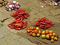 India - Colours of India - vegetable laid out for sale (2458858248).jpg