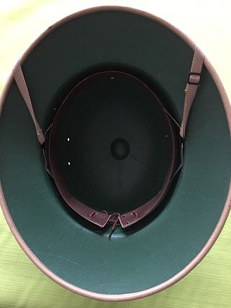 American fiber helmet - International Hat Company pressed fiber sun helmet interior design.  This post–World War II model features a detachable liner and chinstrap, unlike the original model.
