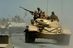 Iraqi Army - Iraqi Asad Babil tanks and an M113 APC from the Iraqi Army 9th Mechanized Division pass through a highway checkpoint in Mushahada, Iraq.