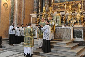 Solemn Mass - Ite missa est sung by the deacon at a Solemn Mass at Santissima Trinità dei Pellegrini, Rome