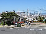 J Church train and San Francisco skyline, April 2018.JPG