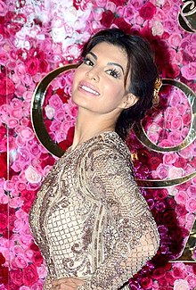 Jacqueline Fernandez posing away from the camera