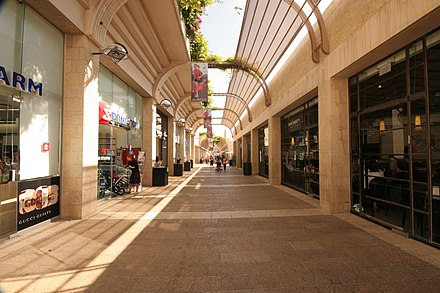 Mamilla Mall adorned with upscale shops stands just outside the Old City Walls. Jerusalem Israel, Jerusalem - Shopping de Rua (5172398236).jpg