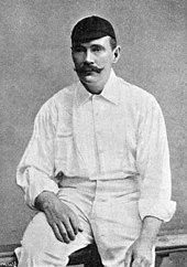 A man dressed in cricket whites