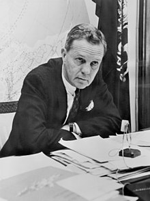 Black-and-white photograph of Joseph S. Clark seated at a desk