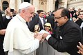 K.V. Thomas presenting a booklet containing the salient features of the Food Security Act to His Holiness Pope Francis.jpg