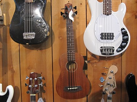 "A selection of electric basses at a music store in Louisville, Kentucky. KALA U-Bass short scale 21"" bass, AWESOME BASS, music store, Louisville, KY.jpg"